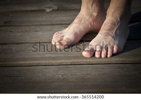 Male bare feet close-up - stock photo