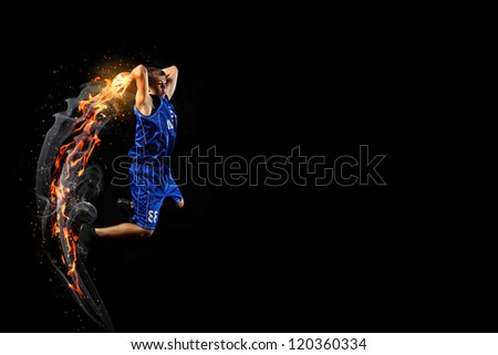Male basketball player jumping and practicing with a ball - stock photo
