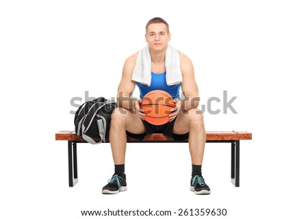 Male basketball player sitting on a bench isolated on white background - stock photo