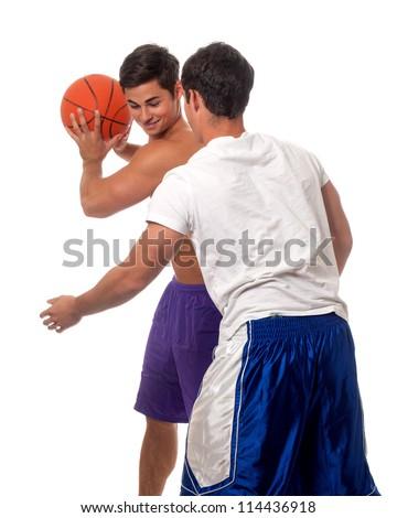 Male basketball players. Studio shot over white. - stock photo