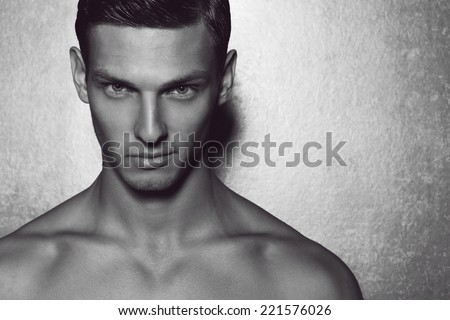 Male Beauty Concept. Portrait Of Fashionable And Undressed Young Man With  Stylish Haircut Posing Over