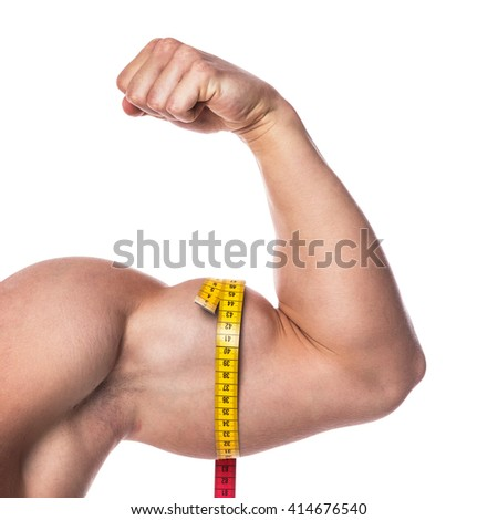 Male biceps and measuring tape on white background