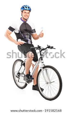 Male biker sitting on his bike and holding a water bottle isolated on white background