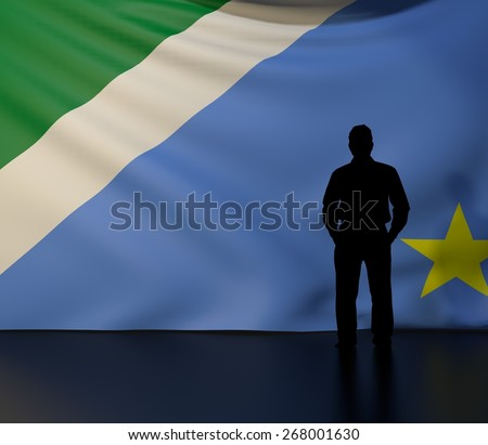 Male black silhouette standing in front of the Mato Grosso do Sul state flag