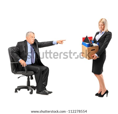 Male boss firing a female employee isolated on white background - stock photo