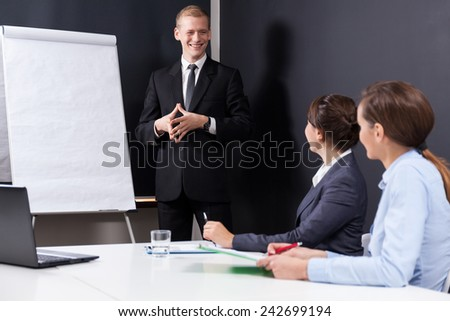 Male boss presenting company data at work