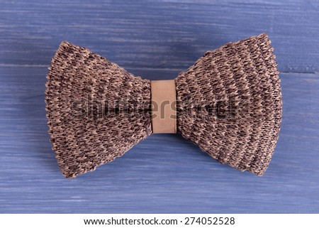 Male bow tie on color wooden table background - stock photo