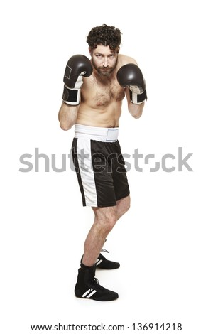 Male boxer in boxing stance ready to fight isolated on white background