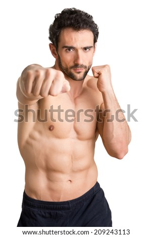 Male boxer ready to fight, isolated in white