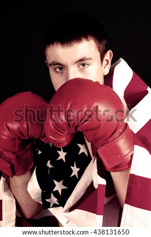 male boxer with hands raised in red boxing gloves, ready to fight - stock photo