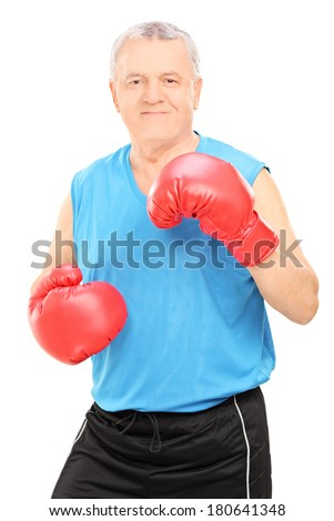 Male boxing coach holding guard and looking at the camera isolated on white background - stock photo