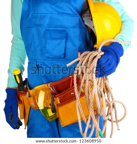 Male builder in blue overalls with rope and helmet isolated on white - stock photo