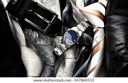 male business accessory set - black leather shoes, belt, watch and tie