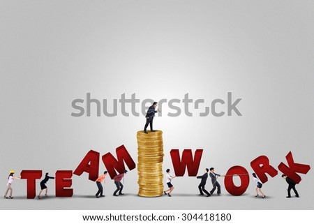 Male business leader with his team make a teamwork text, isolated on white background - stock photo