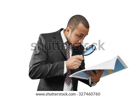 male business man examining document with magnifier - stock photo