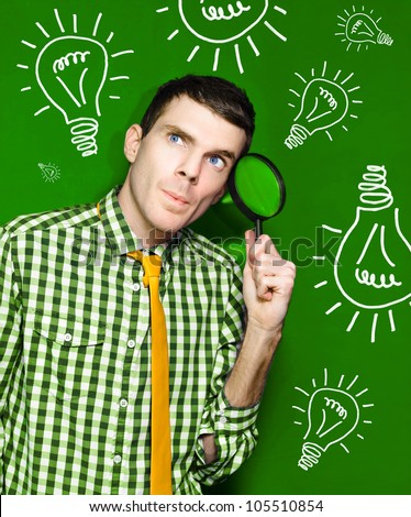 Male Business Person Thinking With Spy Glass To Face In Front Of A Green Light Bulb Background In A Portrayal Of Discovery And Creative Ideas - stock photo