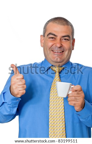 Male businessman in a blue shirt and tie, drinking coffee from a white coffee cup gesturing approvingly smiling isolated on white background - stock photo