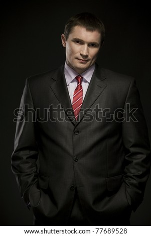 male businessman in business suit on dark background