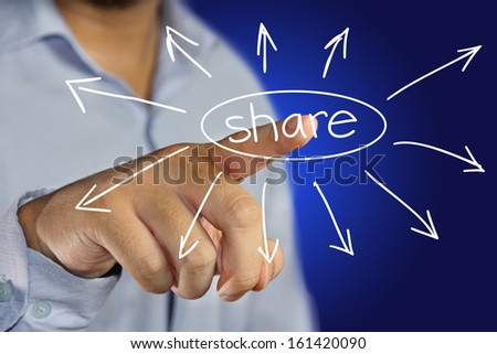 male businessman pointing finger to click share icon on virtual display - stock photo