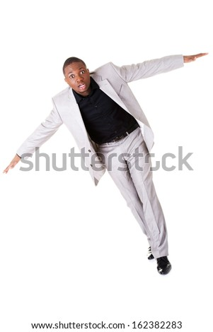 Male businessman with spread arms. Isolated on white.