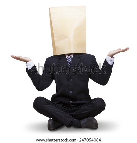 Male businessperson with blindfold on his head, sitting in the studio isolated on white - stock photo