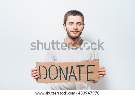 male, cardboard sign donation. On a gray background - stock photo