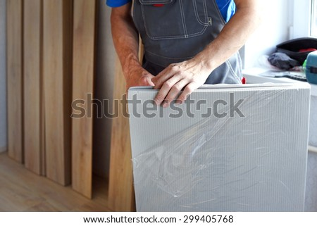 male carpenter selects a substrate for laminate