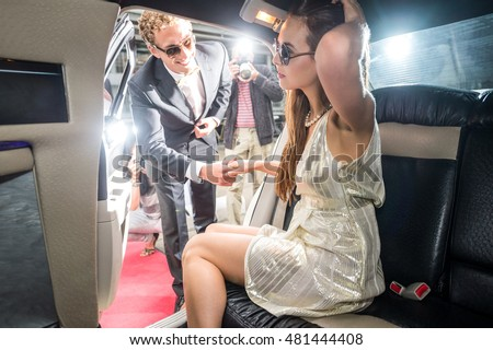 Male Celebrity Helping Girlfriend To Come Out Of The Limo