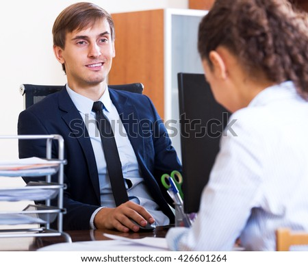 Male cheerful hr manager inreviewing competitor for avalible vacancy - stock photo