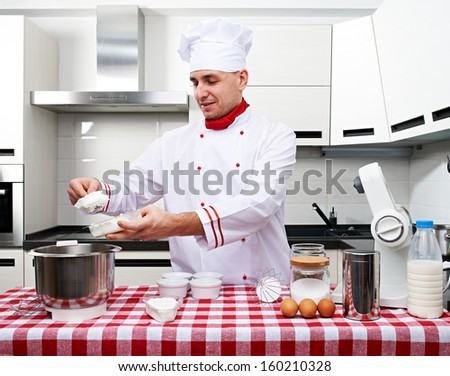 Male chef at kitchen getting ready to cook