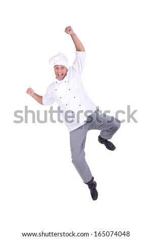 Male chef jumping isolated on white background - stock photo