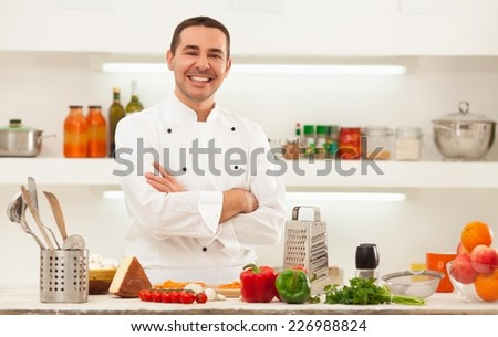 Male chef preparing italian food. - stock photo