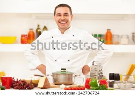 Male chef preparing italian food. - stock photo