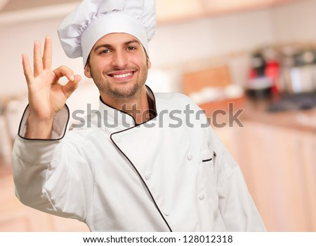 Male Chef Showing Ok Sign, Indoors - stock photo