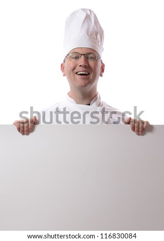 Male chef smiling from behind card isolated on white