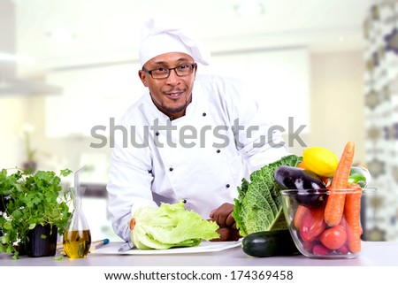Male chef with fruit and vegetables. - stock photo