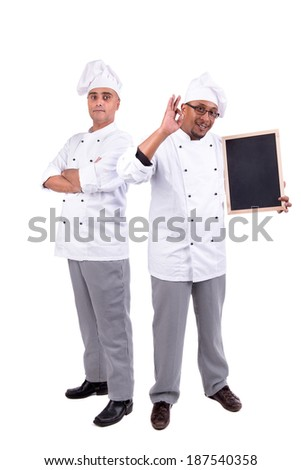 Male chefs team posing isolated on white background - stock photo