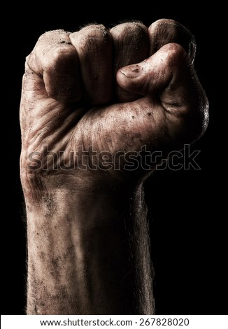 Male clenched fist on black background - stock photo