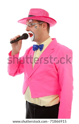 male clown as ringmaster in pink over white background