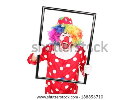 Male clown holding a picture frame isolated on white background
