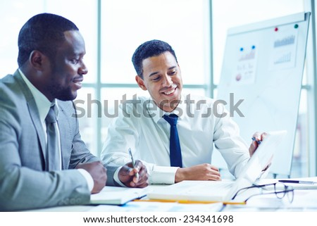 Male colleagues discussing some points - stock photo