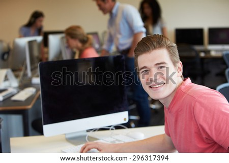 Male College Student Using Computer In Classroom