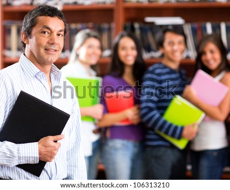Male college teacher with a group of students - stock photo