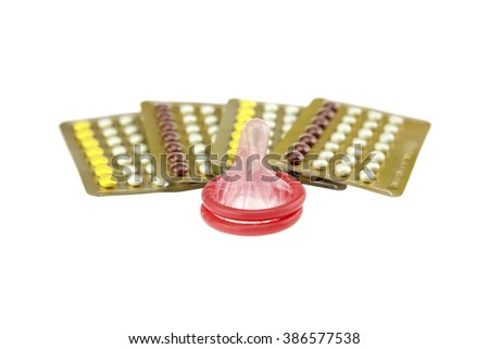 male condom and oral contraceptive., contraception education concept., isolated on white background. - stock photo