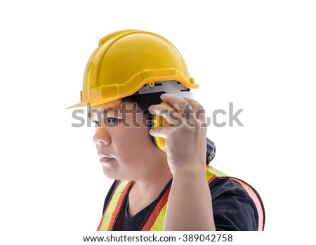 male construction worker with Standard construction safety equipment  and closeup at Ear muffs isolated on white background - stock photo