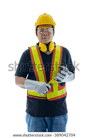 male construction worker with Standard construction safety equipment, hand holding hammer isolated on white background - stock photo