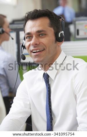 Male Customer Service Agent In Call Centre - stock photo