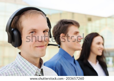 Male customer support operators with smiling - stock photo