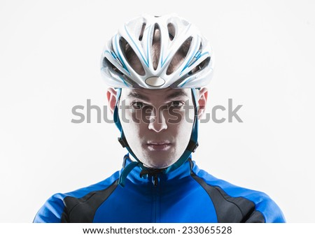 Male cyclist with serious expression shot in high key with white background - stock photo