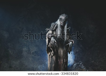 Male demon. Art studio shot. Goth necromancer with horror bodyart - stock photo